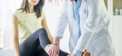 woman with ankle pain seeing doctor